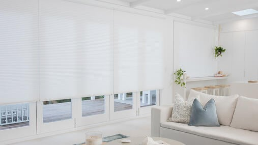 Whisper Shades, known for their insulating properties, installed in open living space
