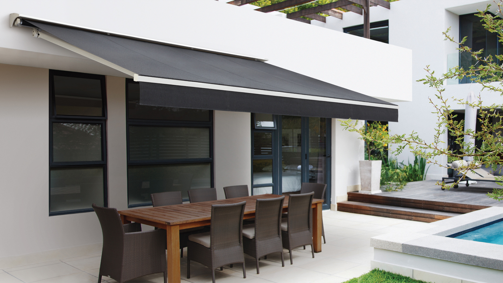 Kona Awnings covering an outdoor dining setting